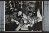 Clara Bow and husband Rex Bell (George Francis Beldam) opening Christmas gifts under the Christmas...
