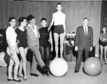 Photograph of Dean Martin and Jack Entratter with Copa Girls at rehearsal, Las Vegas, circa...