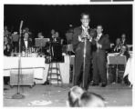 Photograph of Sammy Davis, Jr. performing at the Copa Room in the Sands Hotel, Las Vegas, April...