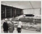 Photograph of Oran Gragson, Leonard Fayle, and I. ''Pat'' Head at reservoir construction site, May...