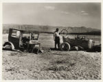 Photograph of two cars abandoned by their owners in St. Thomas, Nevada, April 11, 1948