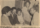 Newspaper clipping, Photograph with black community leaders, Homecoming Committee, publication and...