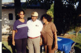 Photograph of Marzette Lewis with her daughter Tracy and Senator Joseph Neal