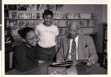 Photograph of Principal Theron Goynes with students, circa 1990