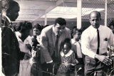 Photograph of Muhammad Ali and Theron Goynes at Highland Elementary School, circa 1969