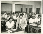 Photograph of Morry Mason teaching a class at the University of Miami, Coral Gables, Florida,...