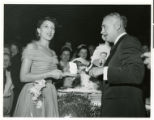 Photograph of Wilbur and Toni Clark at the Desert Inn's first anniversary party, Las Vegas,...