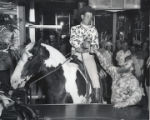 Photograph of a man on a horse in a the Fremont Hotel bar, Las Vegas, circa 1950s