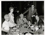 Photograph of Mayor Oran K. Gragson and his wife Bonnie enjoying dinner at the Frontier Hotel and...