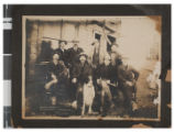 Photograph of eight men outside of the Rawhide Consolidated Mines Company office, Rawhide, Nevada,...