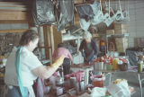 Film transparencies of women preparing food in a garage, probably for a food bank, 1980s