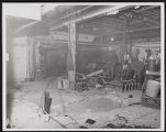 Photograph of construction workers huddled together during Stardust renovation, Las Vegas, (Nev.),...