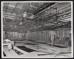 Photograph of room with construction workers for Stardust renovation, Las Vegas, (Nev.), March 18,...
