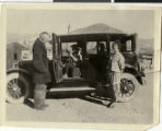 Photograph of Sherwin Garside and family in and around a car, Tonopah, Nevada, 1925.