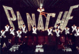 "Photograph of dancers in front of ""Panache"" sign, Paris, France, 1985"