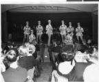 Photograph of Copa Girls in hats and blazers performing onstage at the Sands Hotel, Las Vegas,...