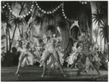 Photograph of female dancers performing in a tropical scene of the Lido de Paris in Paris, France,...