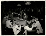 Photograph of gamblers at a baccarat table in the Sahara Hotel and Casino (Las Vegas), circa 1970s