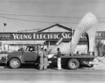 Photograph of the Silver Slipper electric sign in front of the Young Electric Sign Company (Las...