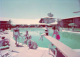 Film transparency of women around a diving board at  Wilbur Clark's Desert Inn (Las Vegas), circa...