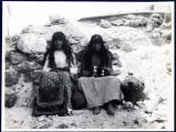 Photograph of Western Shoshone girls with puppies, Goldfield (Nev.), early 1900s