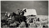 Photograph of a group in covered wagon at Round Valley