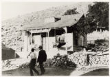 Photograph of pedestrians in front of the Charles D. Marriage Assay office in Pioche, Pioche...