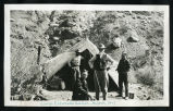 Photograph of four men in front of a tent in Eldorado Canyon, Nelson (Nev.), March, 1907