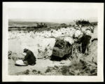 Postcard of men repacking a wagon after crossing a wash, Meadow valley Wash (Nev.), 1900-1925