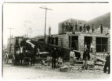 Photograph of a street scene with men working at construction site, Goldfield (Nev.), 1906