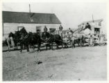 Photograph of stagecoaches passing through southern Nye county (Nev.), 1900-1925