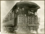Photograph of William Andrews Clark and party on a private railroad car, 1900-1925