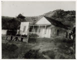 Photograph of a house on hillside in Pioche, (Nev.), 1900-1925
