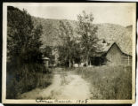 Photograph of a dirt road to ranch a house and outbuildings, Las Vegas (Nev.), 1908