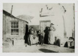 Photograph of Mrs. Lois McGonagill and children in front of Cash store, Tonopah (Nev.), 1902