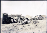 Photograph of women and children posing on Main Street, Goldfield (Nev.), early 1900s