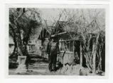 Photograph of a man standing near the Stewart Ranch buildings, Las Vegas (Nev.), 1900-1925