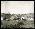 Photograph of tents and headframe in mining camp, (Nev.), 1906