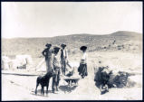 Photograph of men, woman, and dogs at Velvet Lease (Nev.), early 1900s