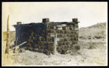 Photograph of a house made from metal cans, Goldfield (Nev.), 1900-1920