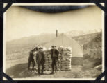 Photograph of miners with sacks of ore from Round Mountain (Nev.), early 1900s