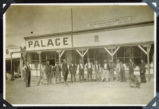 Photograph of men and dogs posing in front of general store and cafe, Round Mountain (Nev.), early...