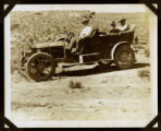 Photograph of men riding in the Desert Maiden automobile, Round Mountain (Nev.), early 1900s