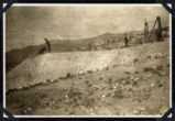 Photograph of a man dumping excavated rock, Round Mountain (Nev.), 1900-1925