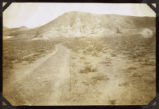 Photograph of road leading to mines, Round Mountain (Nev.), early 1900s