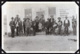 Photograph of a crowd of people in front of Round Mountain Banking Corporation, Round Mountain...