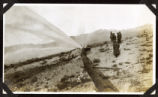 Photograph of men inspecting a burst pipeline, Round Mountain (Nev.), early 1900s