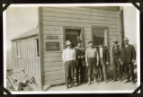 Photograph of men standing in front of Justice of the Peace and Recorder office, Round Mountain...