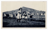 Photograph of two little girls with dolls, Goldfield (Nev.), early 1900s